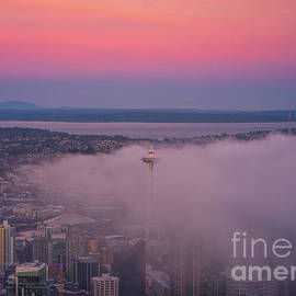 Space Needle in the Clouds at Sunrise by Mike Reid