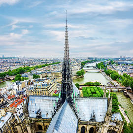 Spire of Notre Dame Cathedral in Paris by Alexios Ntounas