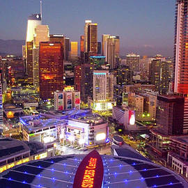 Staples Center and downtown Los Angeles glowing by Josh Fuhrman