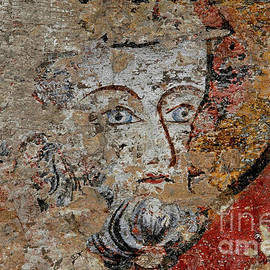 Staring blue eyes amid medieval fresco fragments in Beauvais Cathedral, Oise, northern France by Terence Kerr
