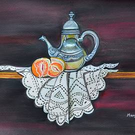 Still life with orange and teapot on lace by Manjiri Kanvinde