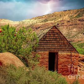 Storm Over Captain Smith's Cabin Colorado by Janice Pariza