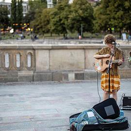 Street artist in Berlin by Rick Neves