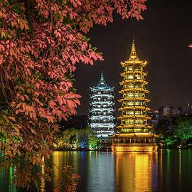 Sun And Moon Pagodas by Elvira Peretsman