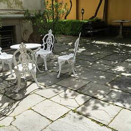 Sun Dappled Invitation - Ubercharming Courtyard with Elegant Cast Iron Furniture by Georgia Mizuleva