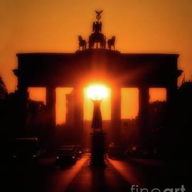 Sun Rising Directly Behind the Brandenburg Gate by Doc Braham