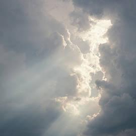 Sunbeam between storm clouds cloudscape sky by Juhani Viitanen