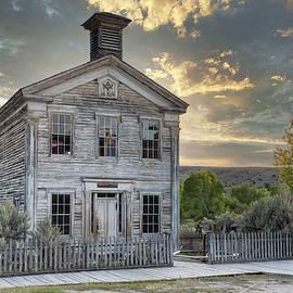 Sundown at the Schoolhouse - Bannack Montana by Stephen Stookey