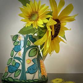 Sunflower in bird vase by Melanie Rissler