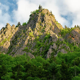 Sunlight plays on a Stone Pinnacle in Dixville Notch, New Hampshire by William Dickman