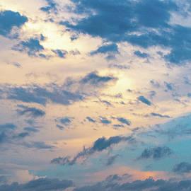 Sunlight Through Clouds by Mary Ann Artz