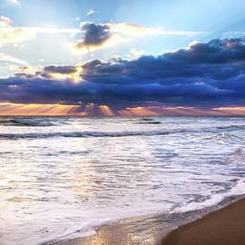 Sunrays over the Ocean by Debra and Dave Vanderlaan
