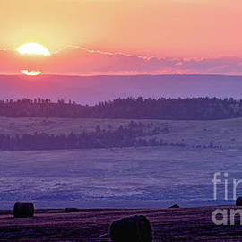 Sunrise Above The Hay Bales by Gary Beeler