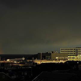 Sunrise and rainbow by Turid Bjornsen