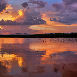 Sunset at the lake after the storm. Autumn. by Guido Montanes Castillo