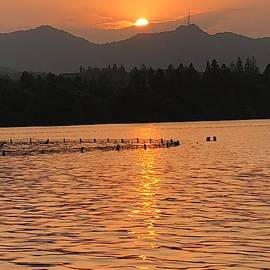Sunset at West Lake - 2 by Lamei Lepschy Bian
