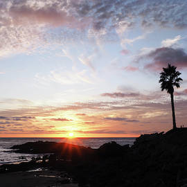 Sunset On The Pacific from Royal Palms by Joe Schofield