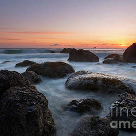 Sunset over the Rock by Mike Dawson