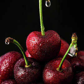 Sweet cherry with water drops by Ivan Mikhaylov