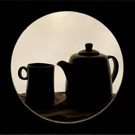 Teapot with cup, still life by Sabrina Ciferri