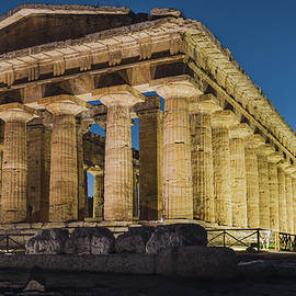 Temple of Neptune at sunset by Umberto Barone