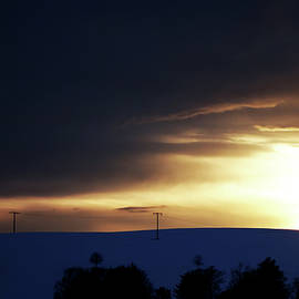 The blue, snowy Field at Sunset by Imi Koetz