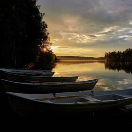 The boats in a row at Koirajarvi by Jouko Lehto