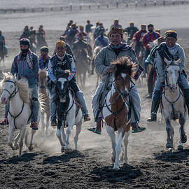 The local horse riders of Mt Bromo by Anges van der Logt