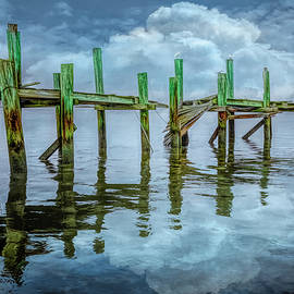 The Old Wooden Docks in the Fog and Clouds by Debra and Dave Vanderlaan