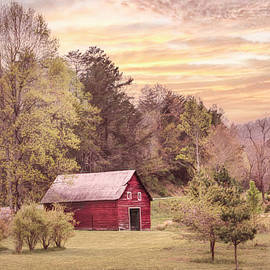 The Red Country Barn at Sunset by Debra and Dave Vanderlaan