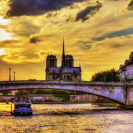The River Seine Sunset And Notre Dame Cathedral In Paris, France by Paul Thompson