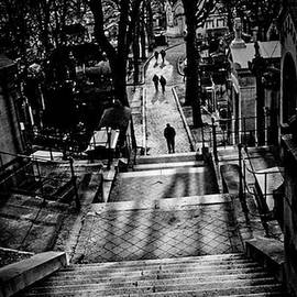 The solitary walk on the spirit path in Peri Lachaise  Cemetery  in Paris. by Cyril Jayant