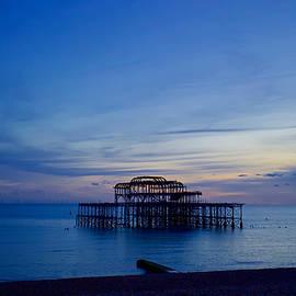 The sun sets on West Pier, Brighton by Joe Vella