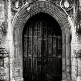 The West Door of St. John Baptist Parish Church in Cirencester
