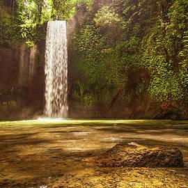 Tibumana waterfall in Bali at the jungle.  by Kristian Sekulic