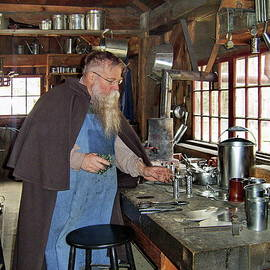 Tinsmith, Old Sturbridge Village, Massachusetts by Lyuba Filatova