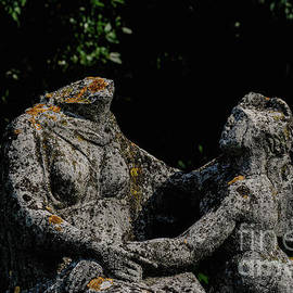 Touching embrace in ancient Roman cemetery at Aquileia, northeast Italy  by Terence Kerr