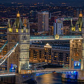 Tower bridge seen at night in London. by George Afostovremea