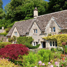 Traditional cottages and flower garden, Bibury, the Cotswolds, England by Neale And Judith Clark