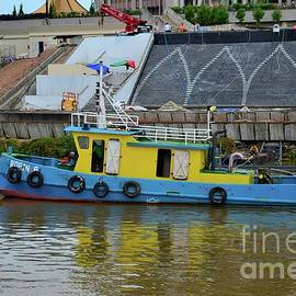 Tugboat works on musical fountain outside parliament building on Sarawak River Kuching Malaysia by Imran Ahmed