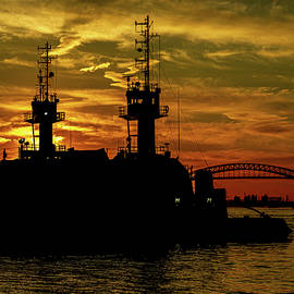 Tugboats at Sunset by Sean Sweeney