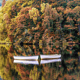Two Rowboats in the Autumn Lake by Debra and Dave Vanderlaan