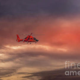US Coast Guard Helicopter Sunset by Mitch Shindelbower