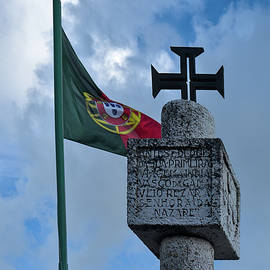 Vasco Da Gama Monument and the flag in Nazare by Angelo DeVal