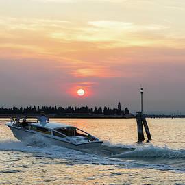 Venetian Water Taxi - Speedboating on the Venice Lagoon at Sunset  by Georgia Mizuleva