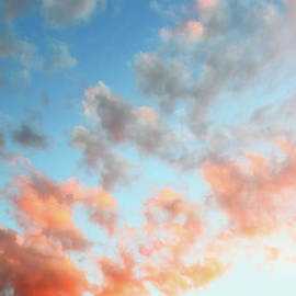 Vibrant orange clouds on gradient blue sky textured background twilight by Gregory DUBUS
