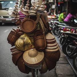Vietnamese hat seller by Josh Kathey
