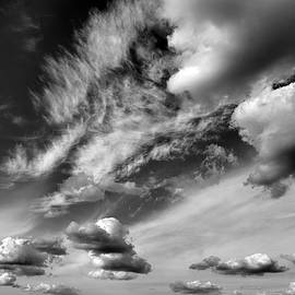 View of clouds of the sky, nature photography, black and white. by Akos Horvath