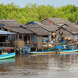 Village River Ca Mau Region  by Chuck Kuhn