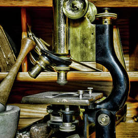 Vintage microscope with a mortar and pestle by Paul Ward